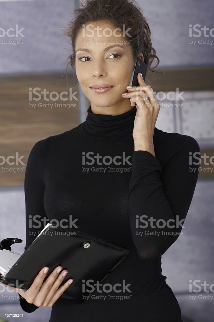 Portrait of beautiful young businesswoman in work stock photo