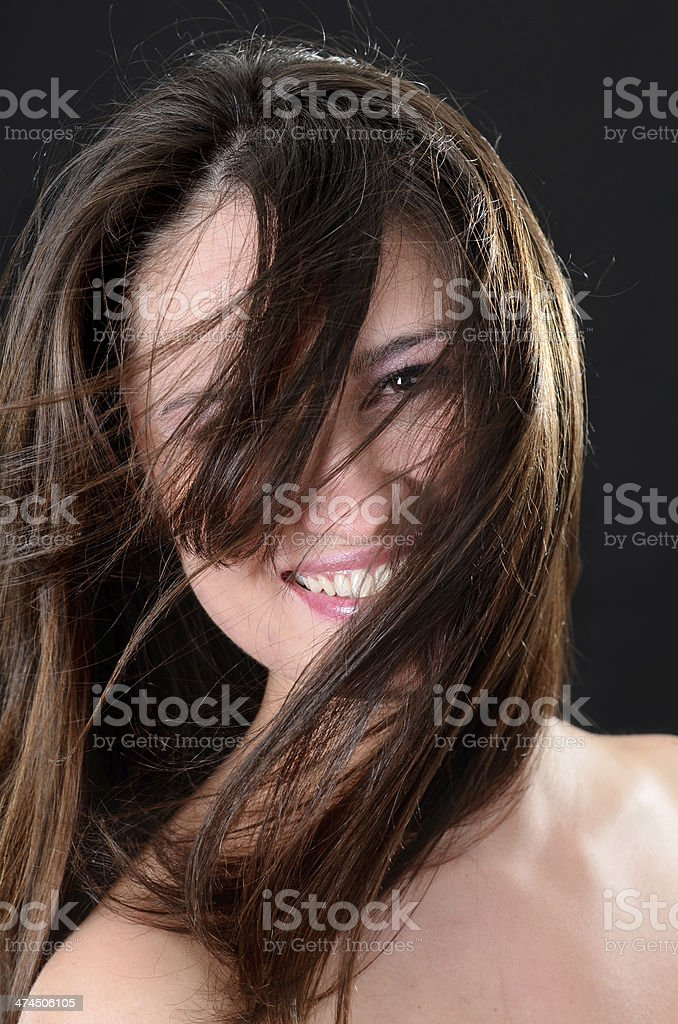 Portrait of beautiful young caucasian woman with flying brown hair royalty-free stock photo