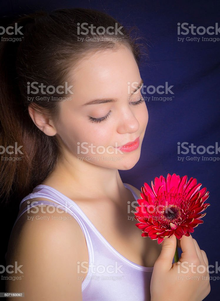 Portrait of beautiful young girl with flower royalty-free stock photo