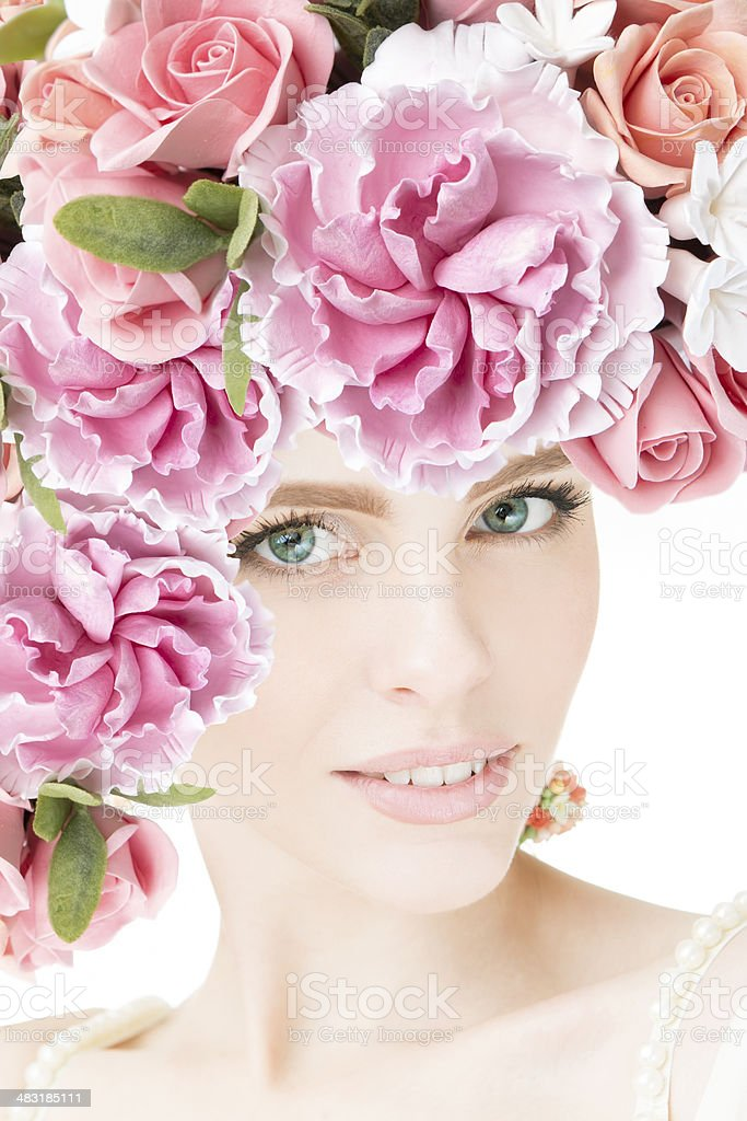Portrait of beautiful young girl with flowers stock photo