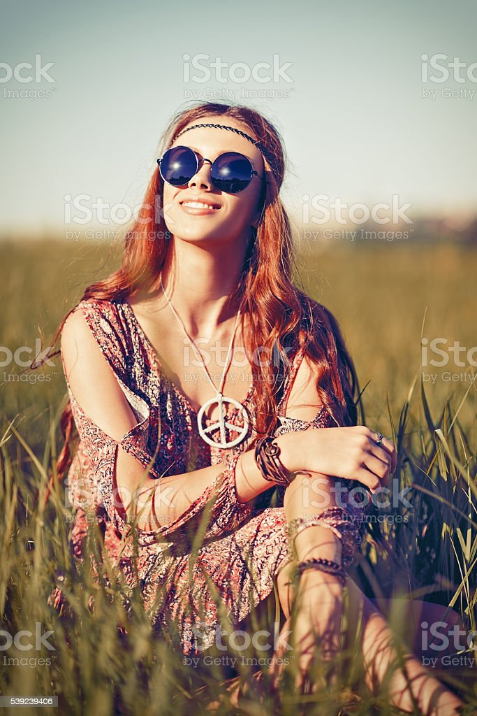 Portrait of beautiful young hippie girl in the field stock photo