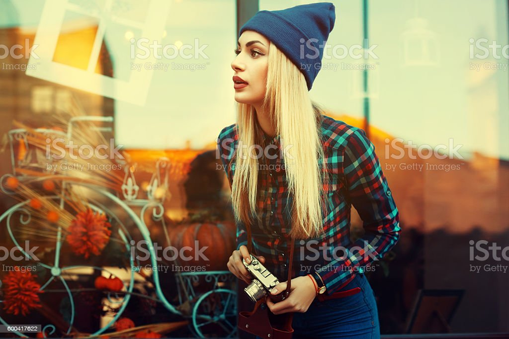 Portrait of beautiful young playful hipster woman with old retro stock photo