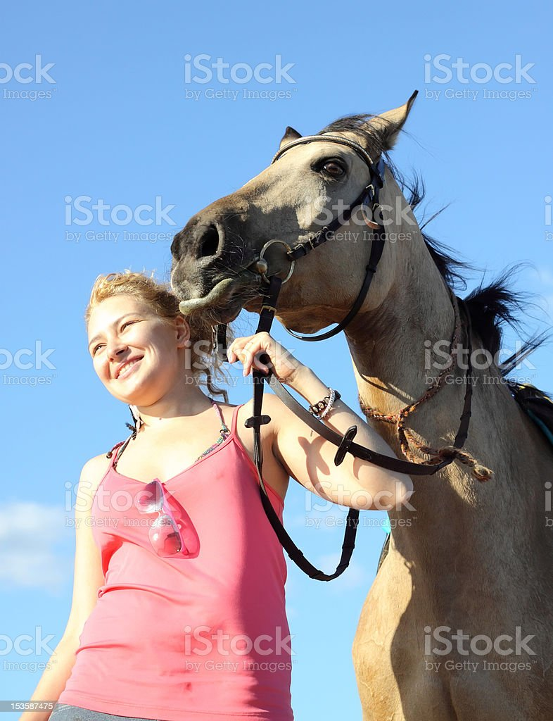 Portrait of beautiful young woman and dun horse royalty-free stock photo
