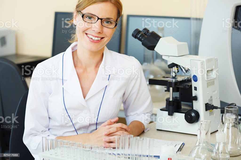 Portrait of beautiful young woman in a laboratory. stock photo