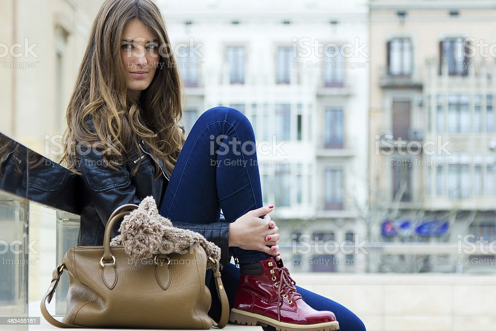 Portrait of beautiful young woman in the city stock photo