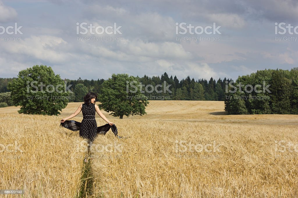Portrait of beautiful young woman in the field stock photo