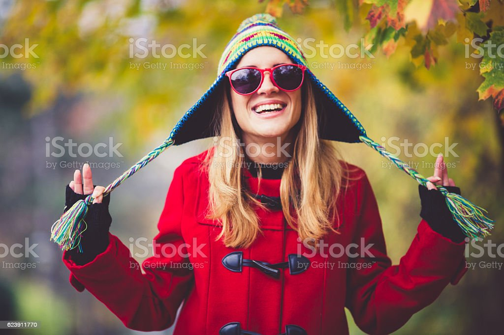 Portrait of beautiful young woman outdoors stock photo
