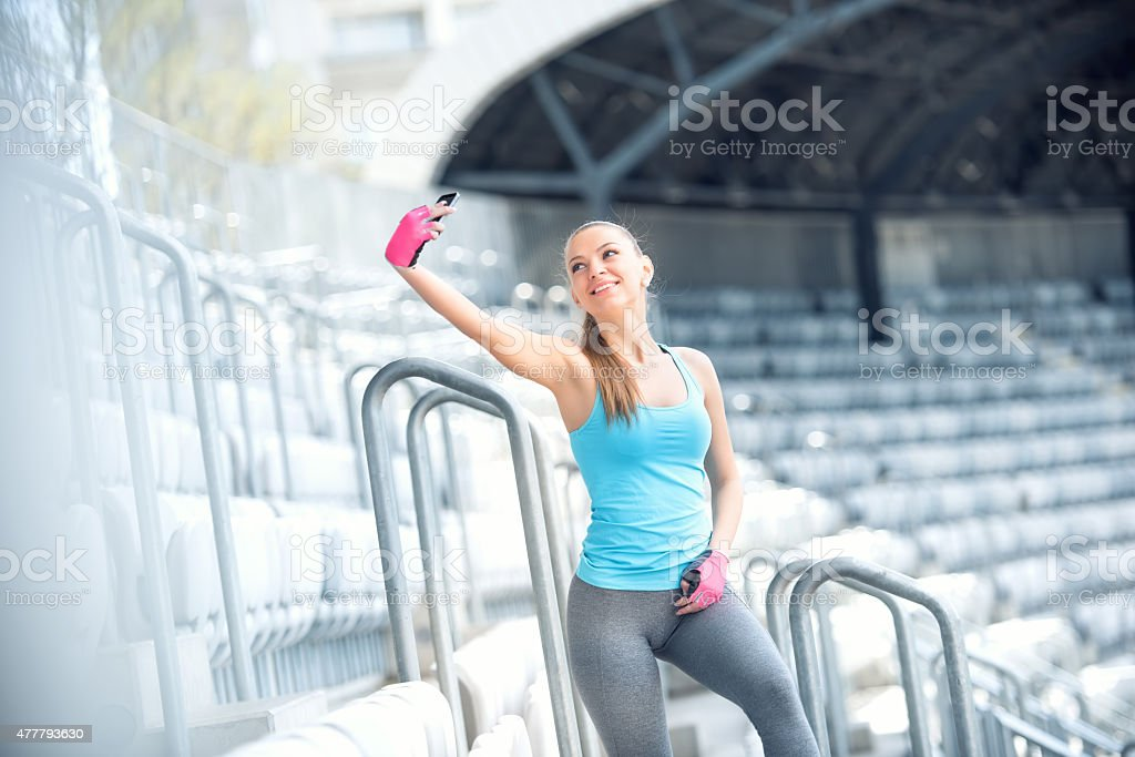 Portrait of beautiful young woman selfie with smartphone. Modern concept stock photo
