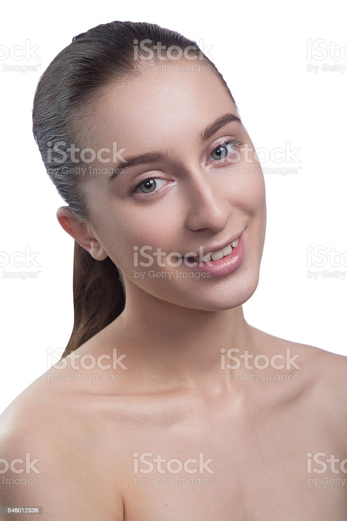 Portrait of beautiful young woman, smiling, looking at camera. stock photo
