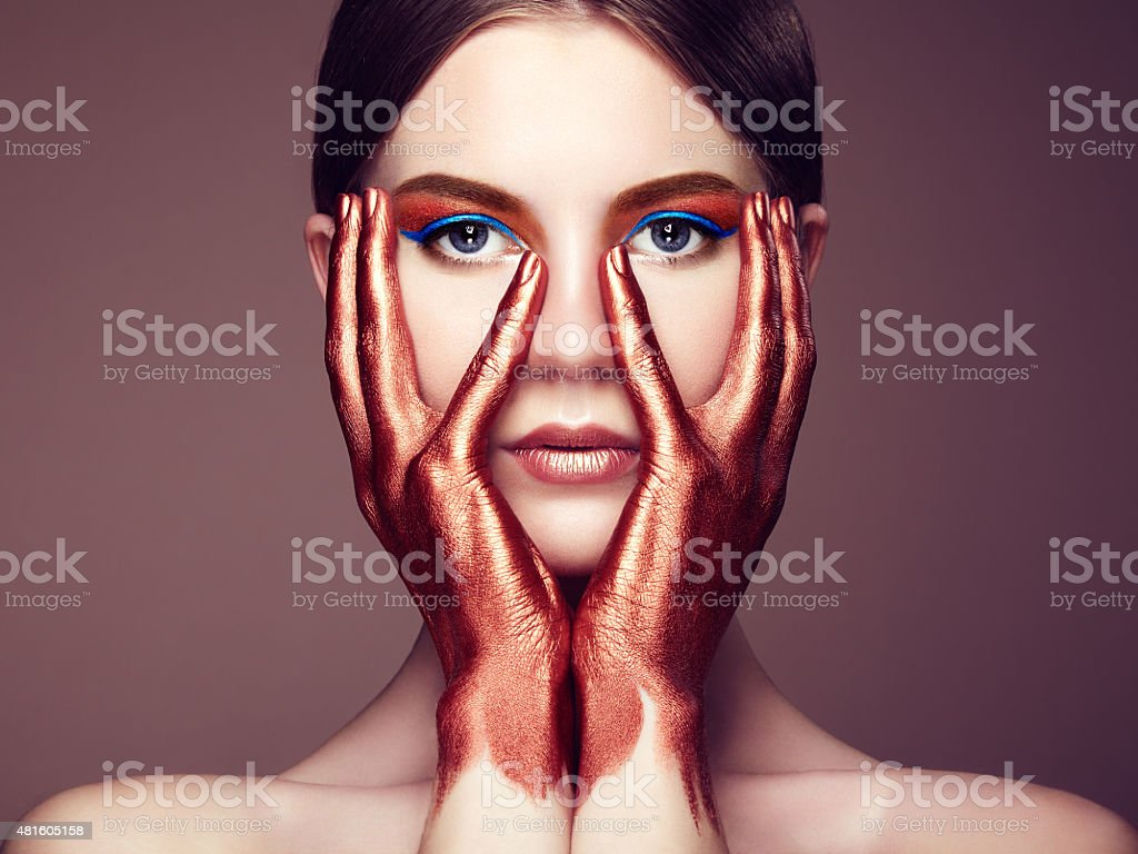Portrait of beautiful young woman with art make-up stock photo