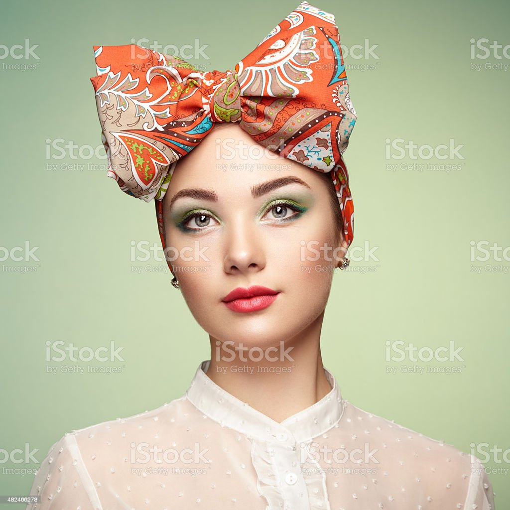 Portrait of beautiful young woman with bow stock photo