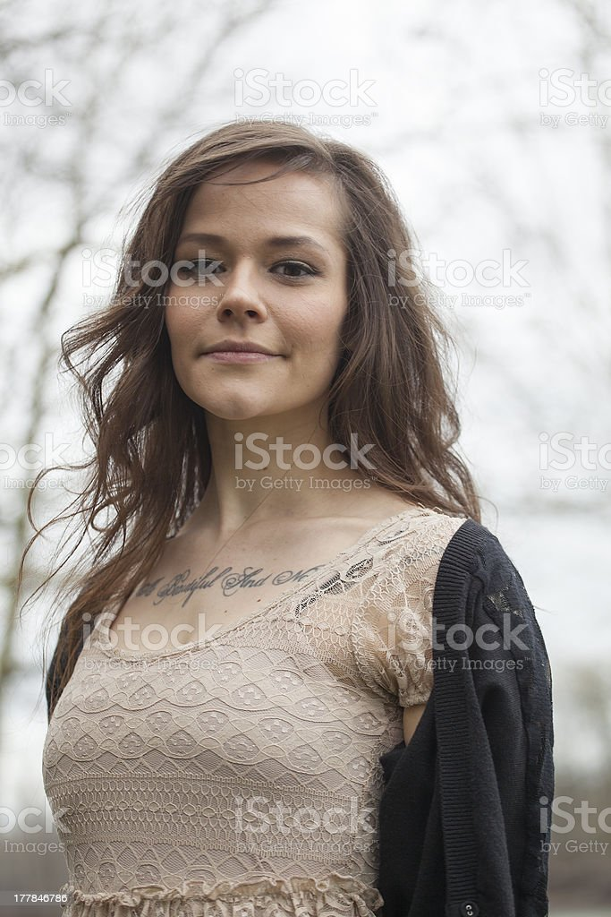 Portrait of Beautiful Young Woman with Brown Hair royalty-free stock photo