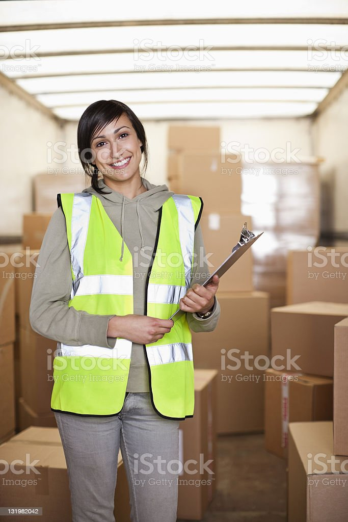 Portrait of beautiful young woman with clipboard stock photo