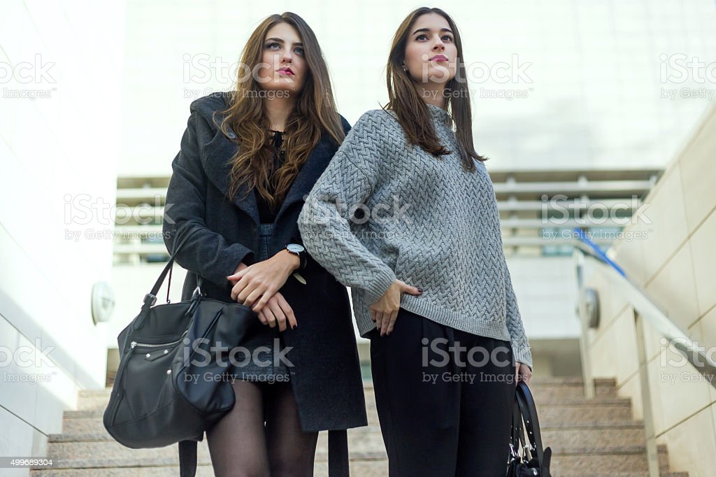 Portrait of beautiful young women posing in the street. stock photo