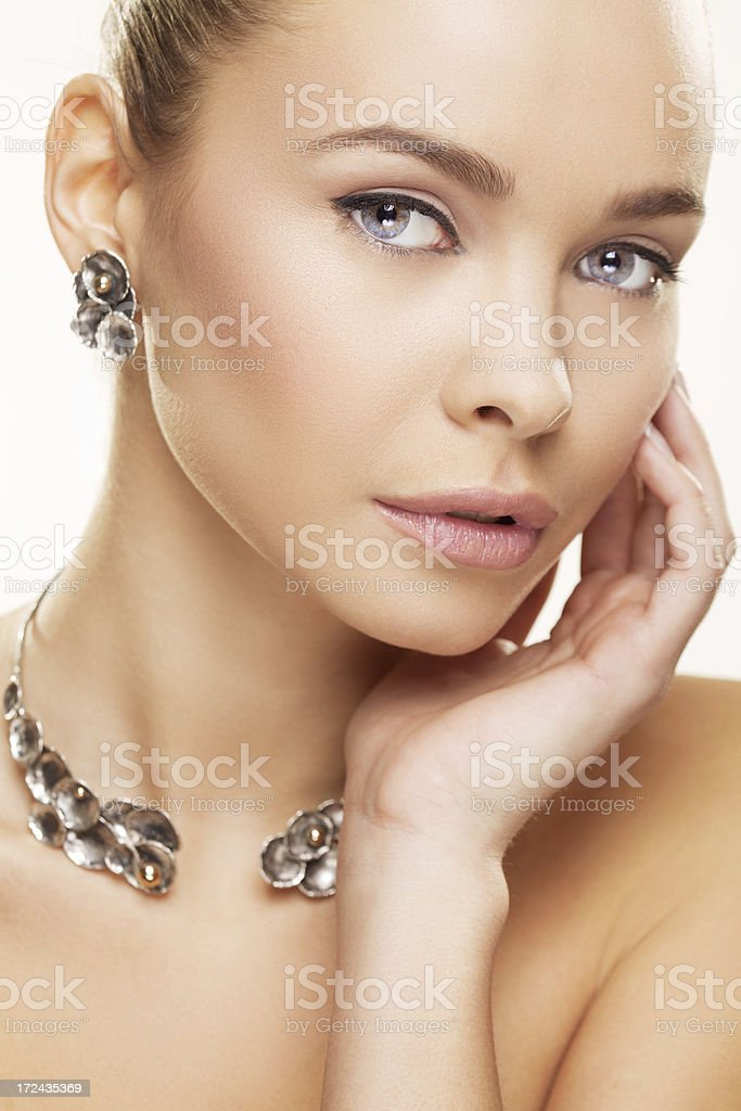 Portrait of beauty wearing a necklace and earrings royalty-free stock photo