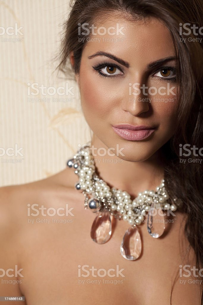 Portrait of beauty wearing a necklace royalty-free stock photo