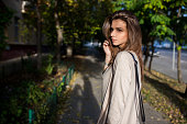 Portrait of beauty woman walking on the street, sunset light