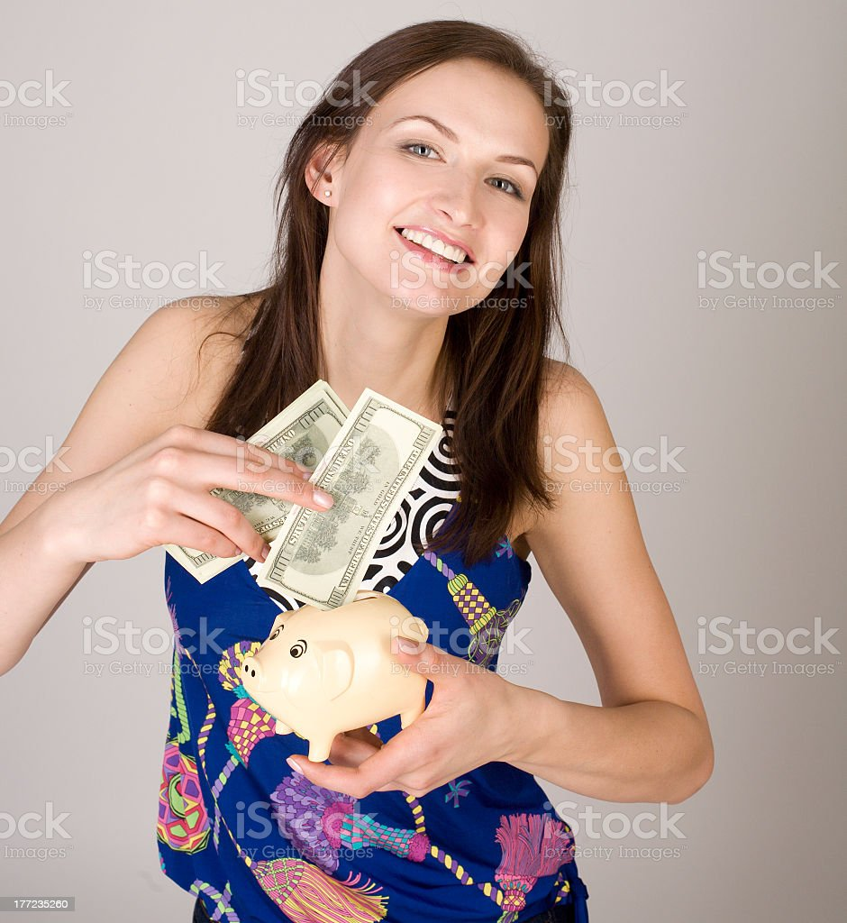 portrait of beauty young woman with piggy bank and money royalty-free stock photo