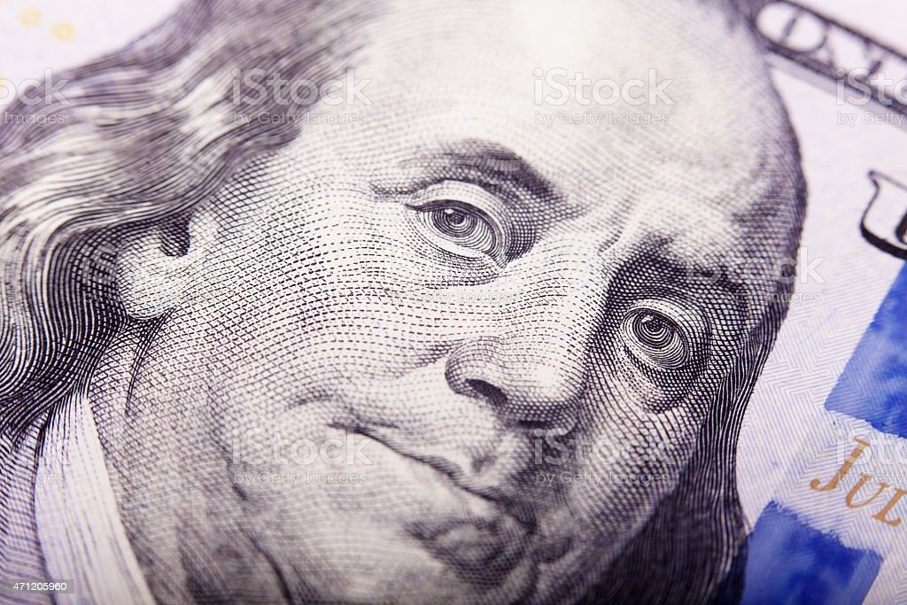 Portrait of Benjamin Franklin from one hundred dollars bill new stock photo