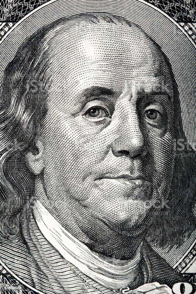 Portrait of Benjamin Franklin on the hundred dollar bill. stock photo