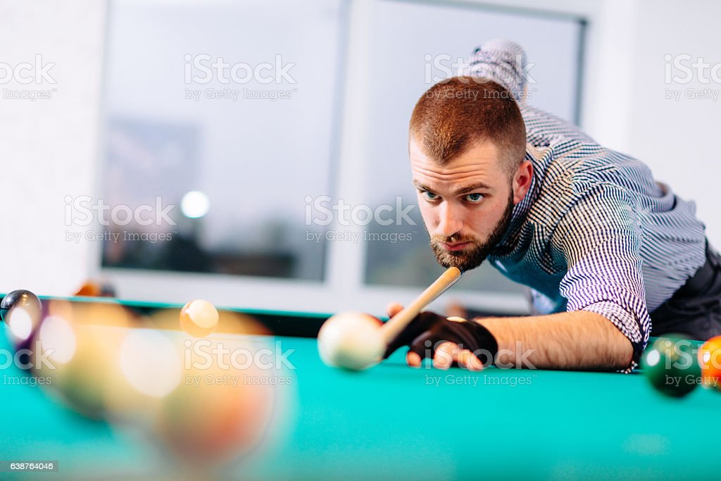Portrait of billiard player aiming during tournament stock photo