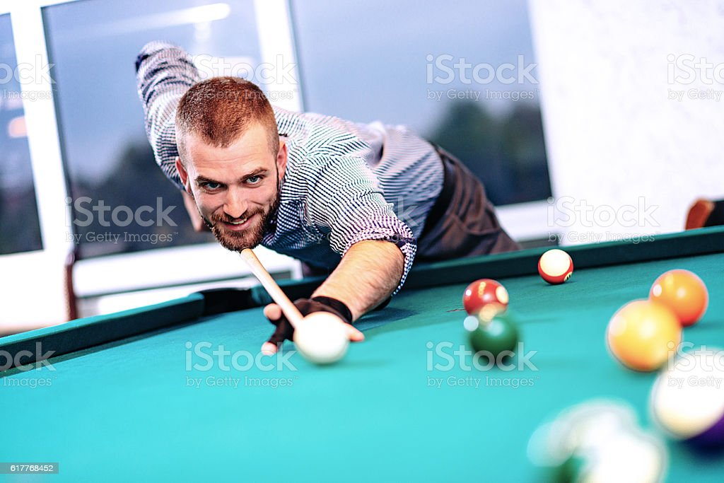 Portrait of billiard player aiming stock photo