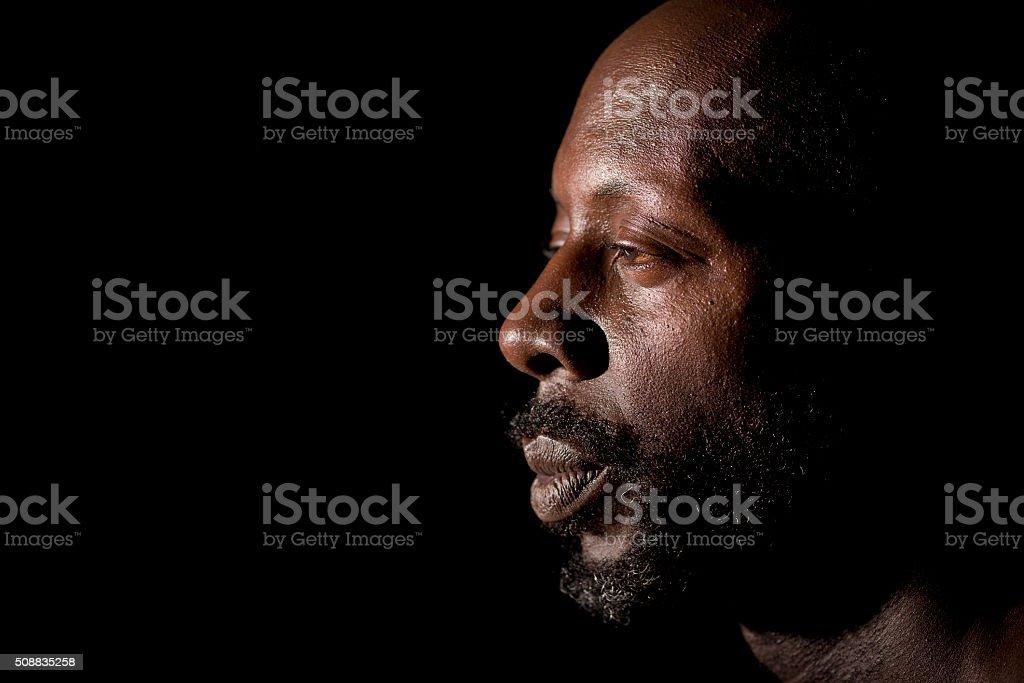 Portrait Of Black Man In Profile stock photo