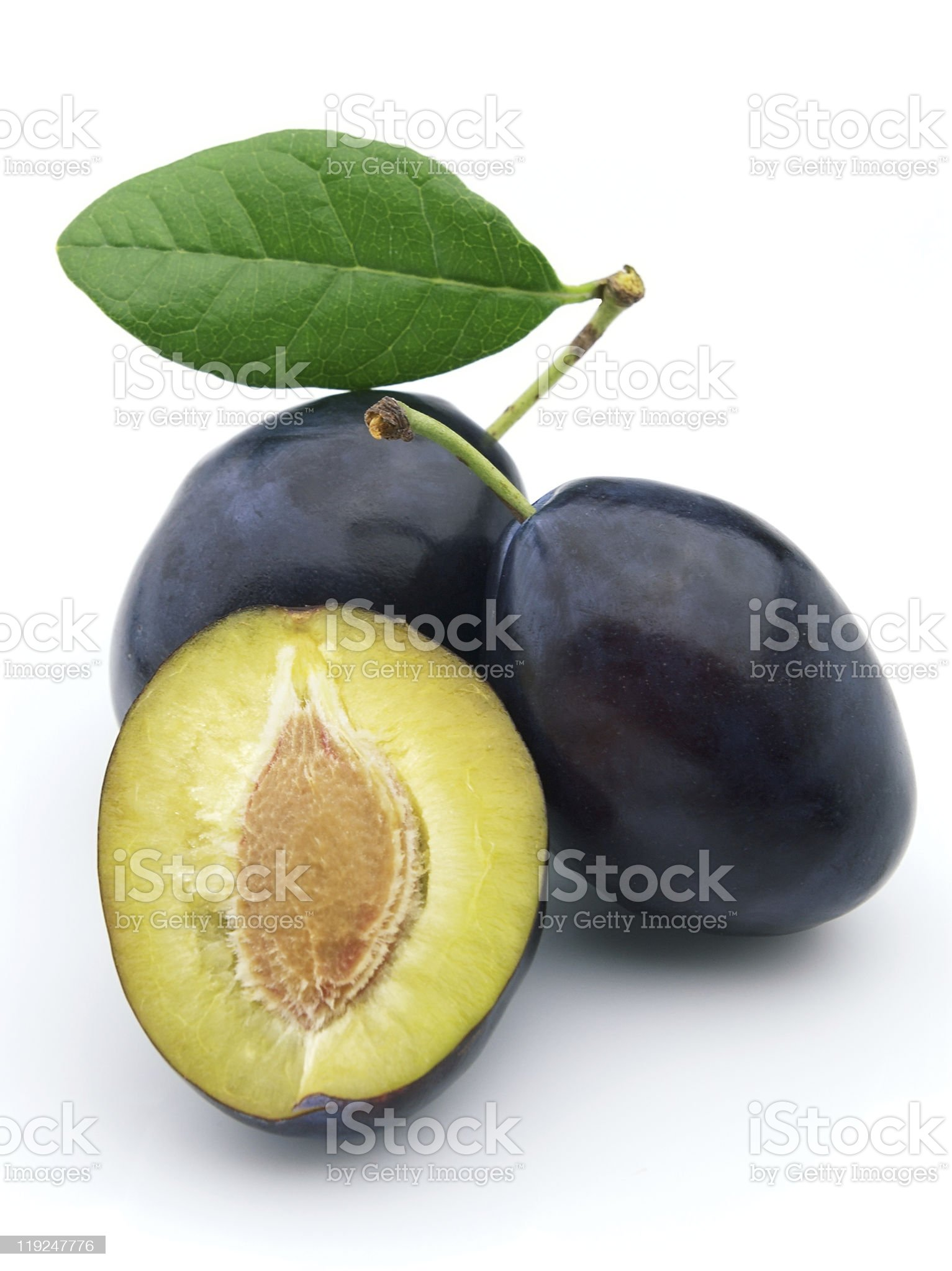 Portrait of black plums with one split to show the center royalty-free stock photo