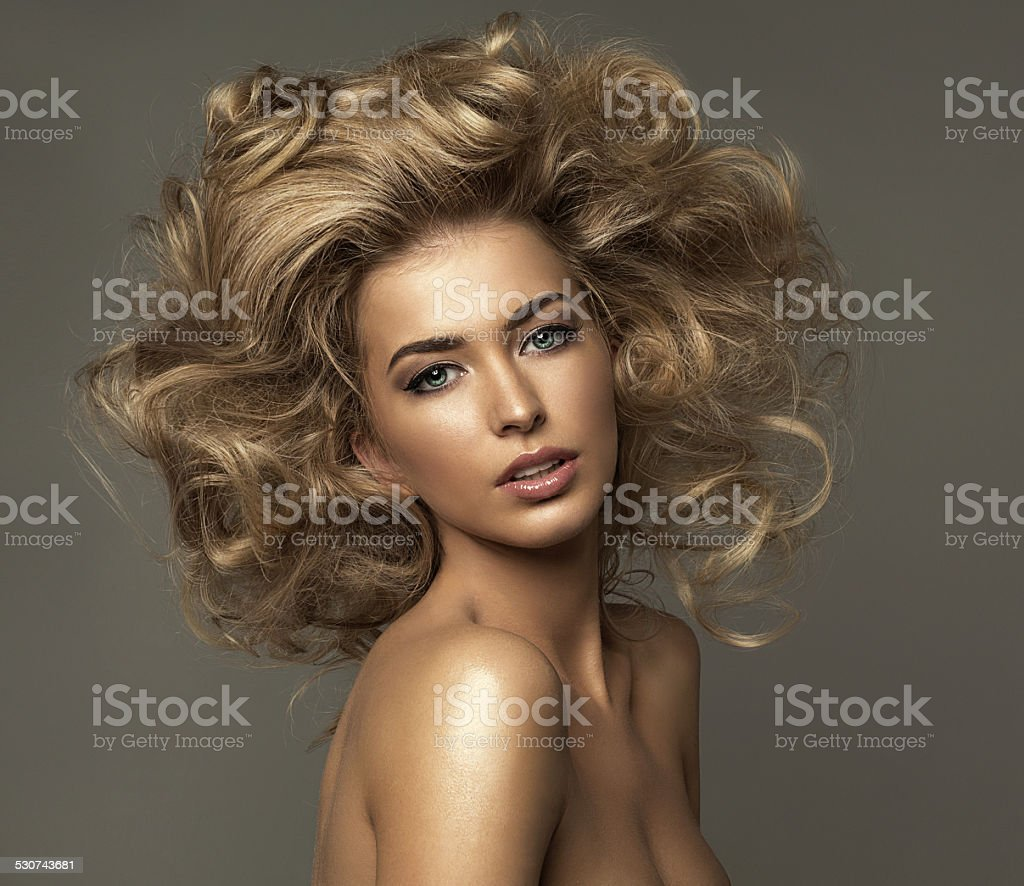 Portrait of blond woman with curls stock photo