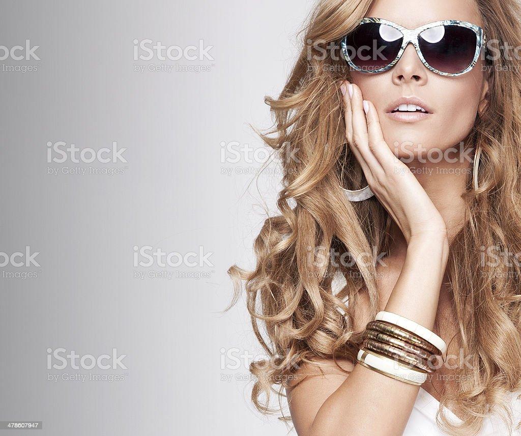 Portrait of blonde girl in sunglasses. stock photo