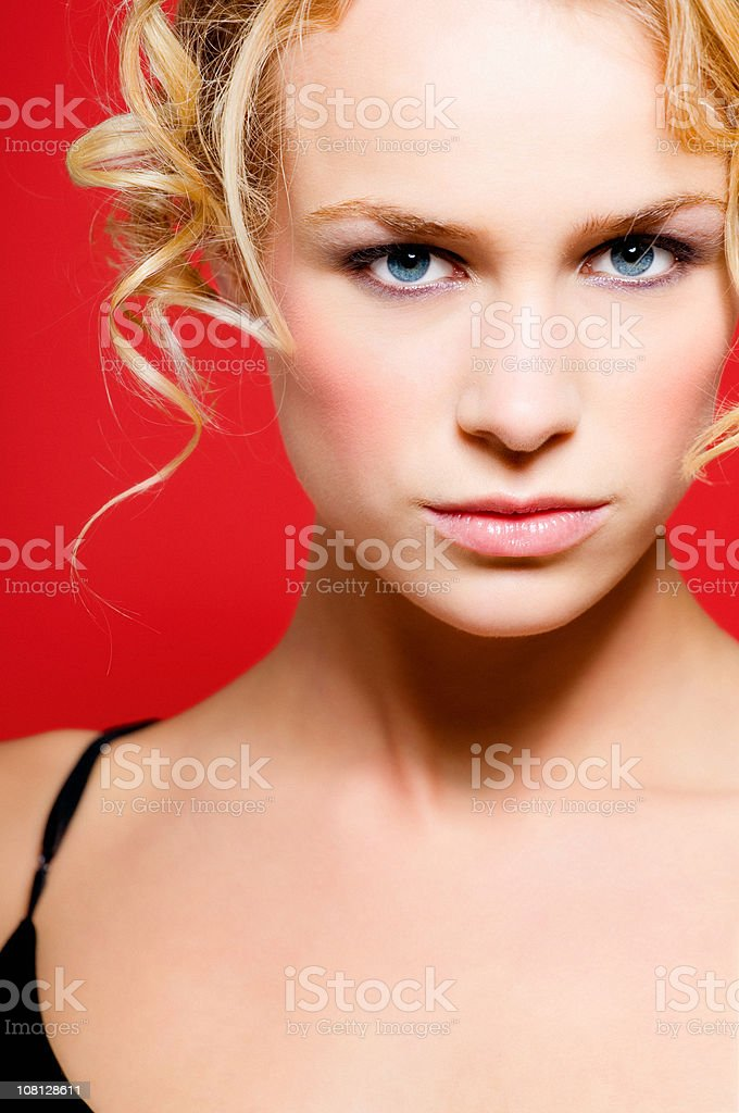 Portrait of Blonde Girl on Red Background royalty-free stock photo