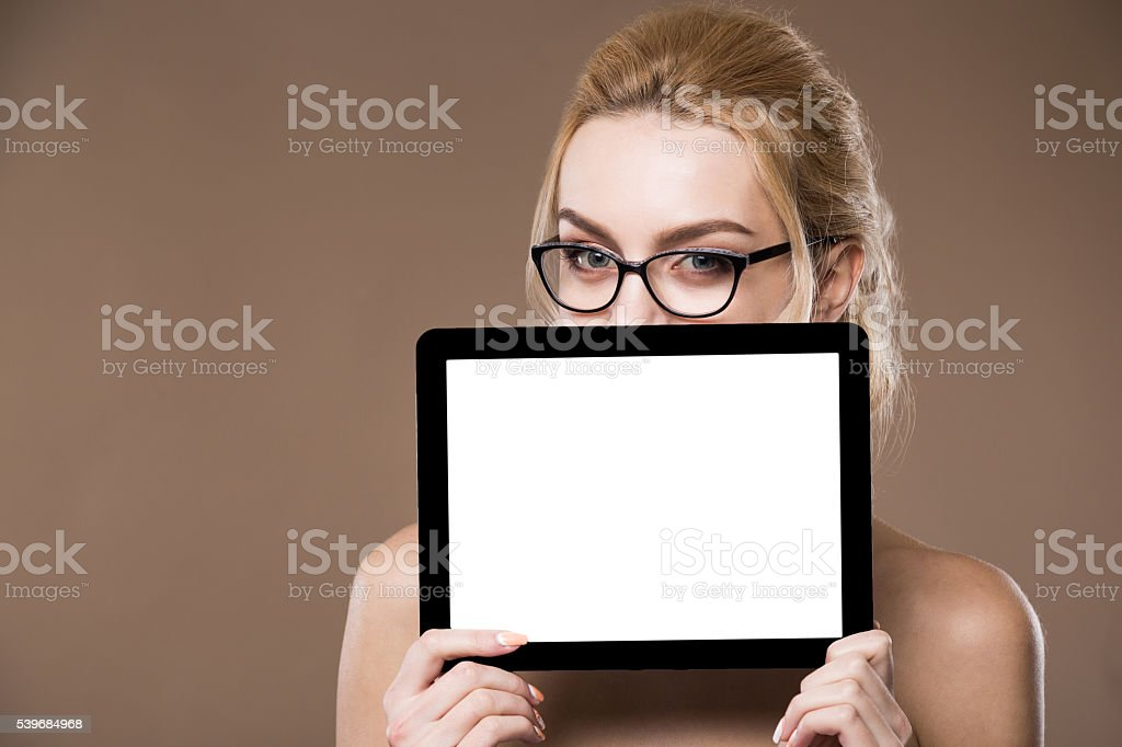 Portrait of blonde in glasses with a tablet in hands stock photo