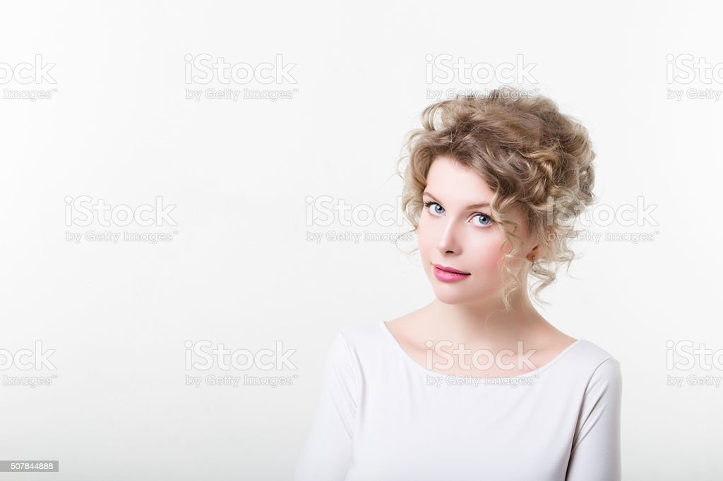 Portrait of blonde with curly hair in studio. stock photo