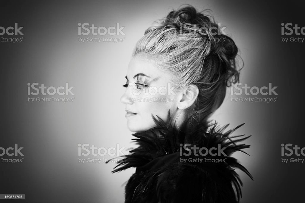 Portrait of blonde with feathers royalty-free stock photo
