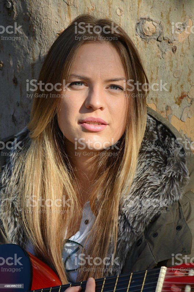 Portrait of blue eyed blonde girl stock photo