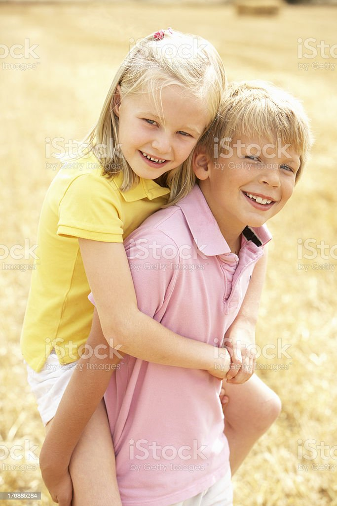 Portrait Of Boy And Girl In Summer Harvested Field royalty-free stock photo