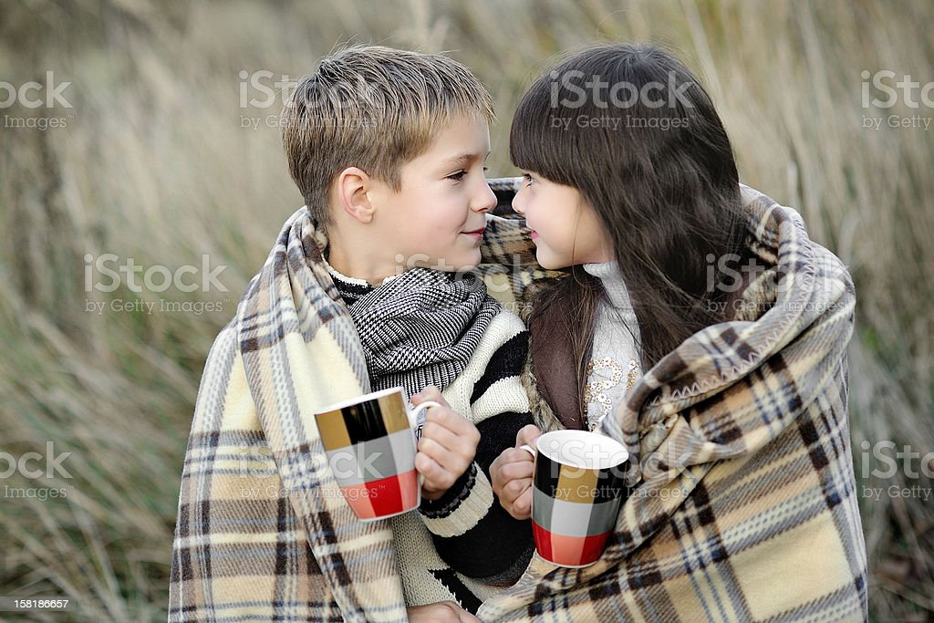 Portrait of boy and girl with plaid stock photo