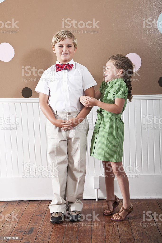 Portrait of boy and little sister stock photo