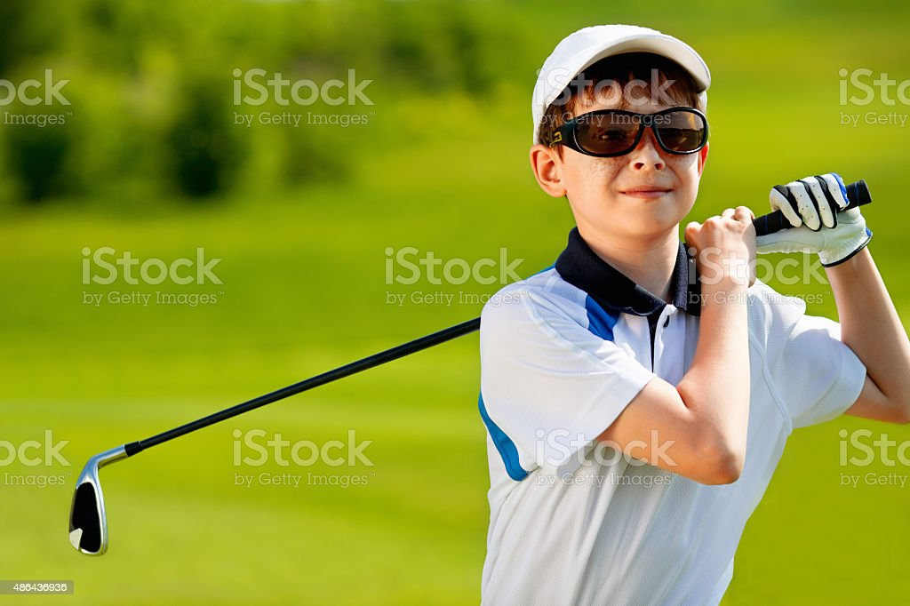 Portrait of boy golfer stock photo