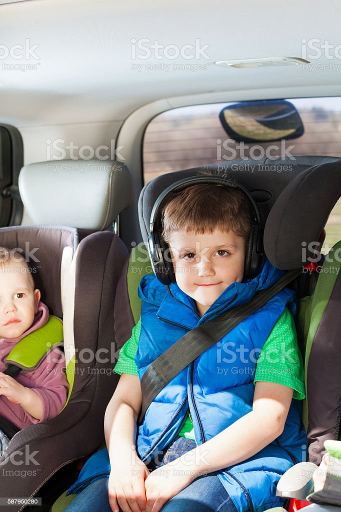 Portrait of boy listening to music in a car trip stock photo
