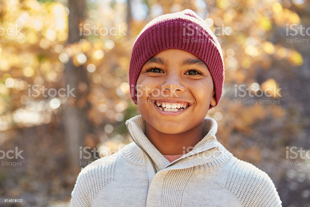 Portrait Of Boy Playing In Autumn Woods stock photo