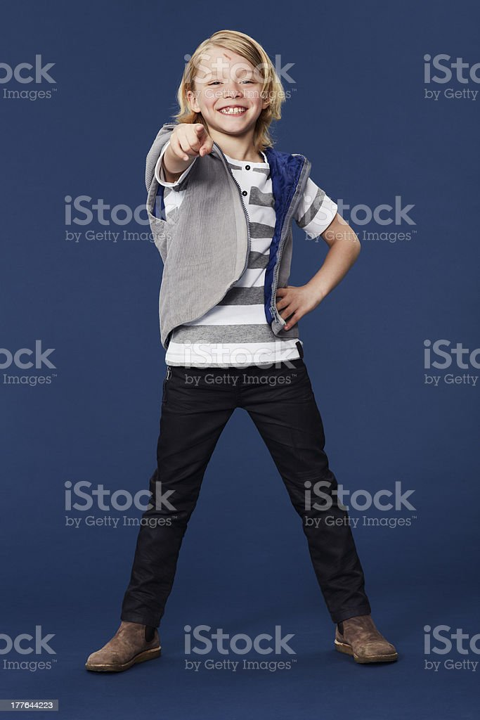 Portrait of boy pointing in studio royalty-free stock photo