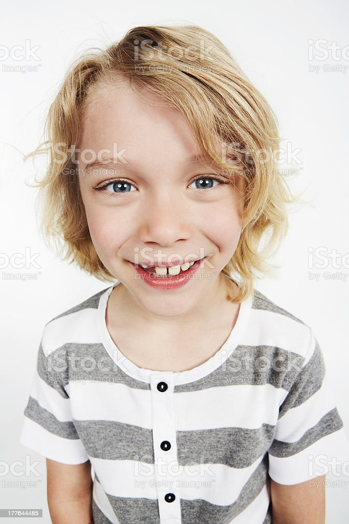 Portrait of boy smiling in studio, close up royalty-free stock photo