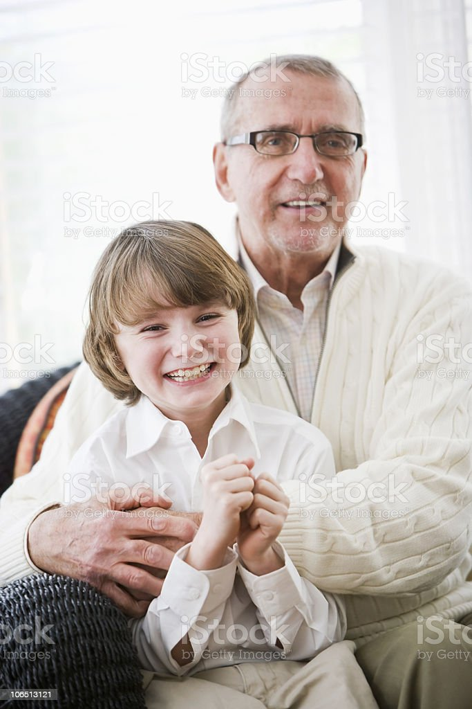 Portrait of boy with grandfather royalty-free stock photo