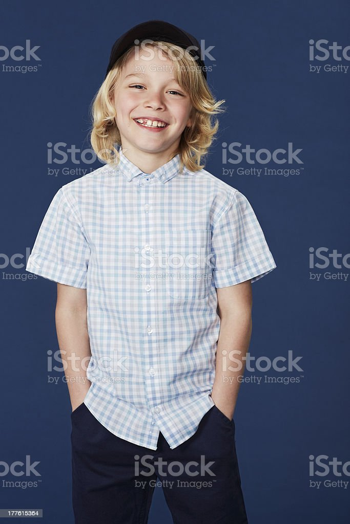 Portrait of boy with hands in pockets royalty-free stock photo