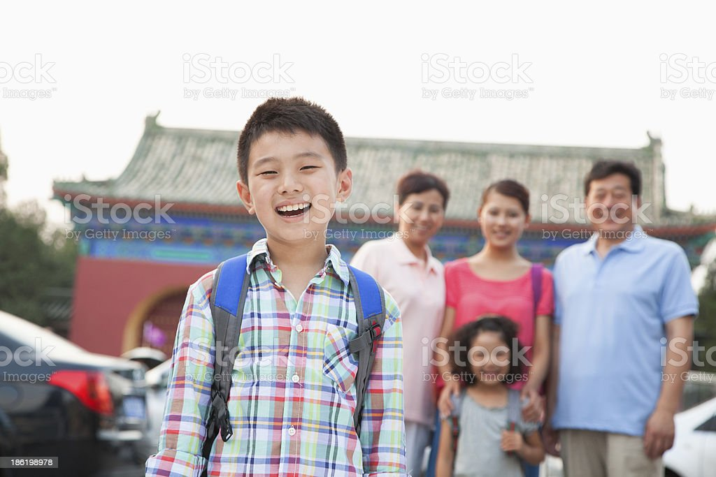 Portrait of boy with his family in the background royalty-free stock photo