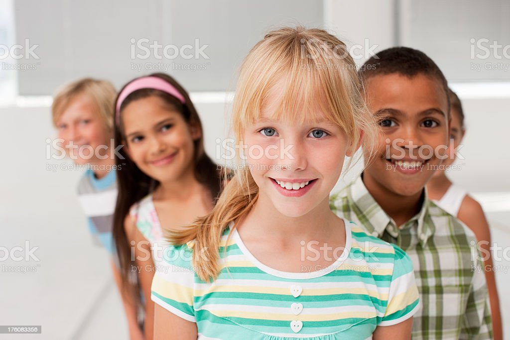 Portrait of boys and girls smiling together stock photo