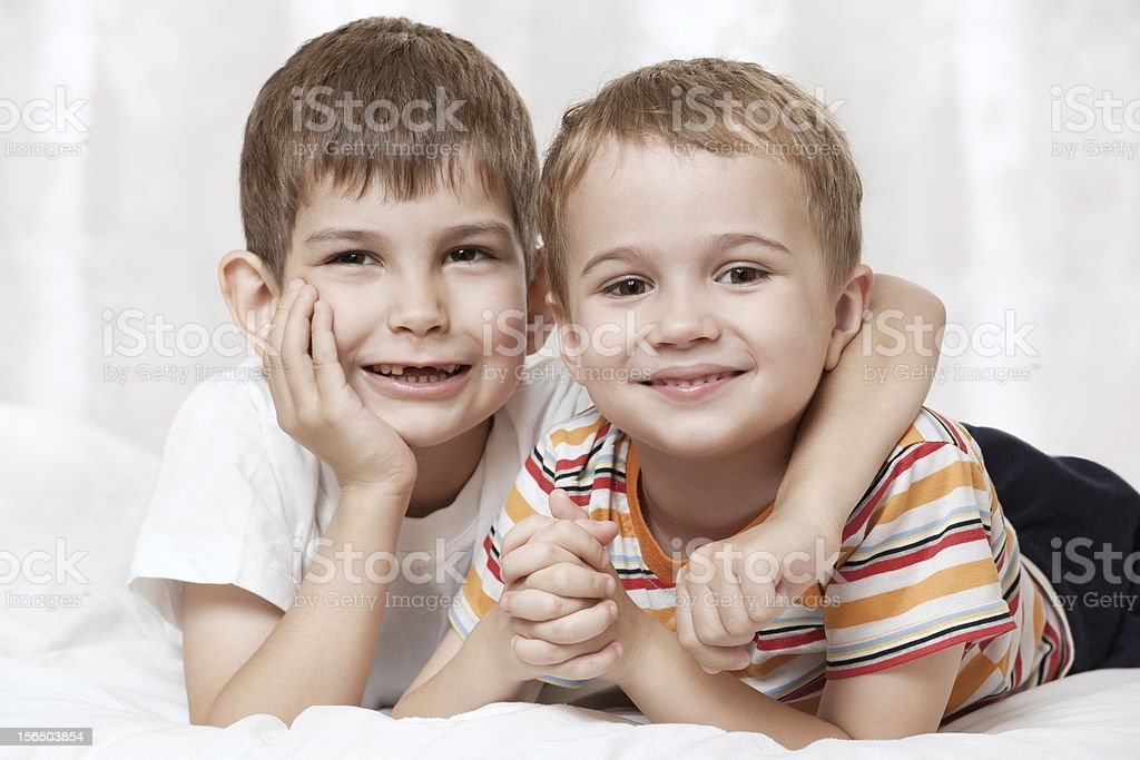Portrait of boys on the bed royalty-free stock photo