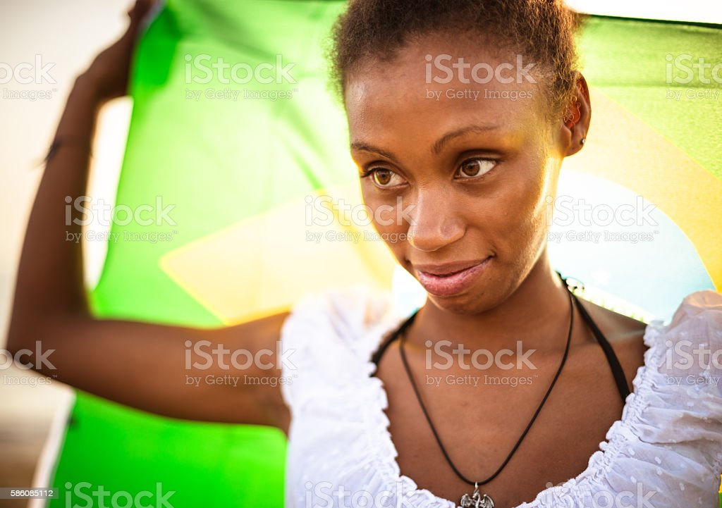 portrait of brazilian girl with flag in Rio de Janeiro stock photo