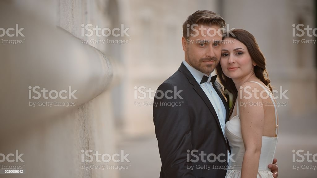 Portrait of bride and groom embracing stock photo